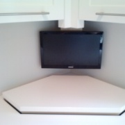 TV over rising cabinet