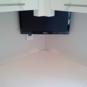 TV lowering over counter cabinet